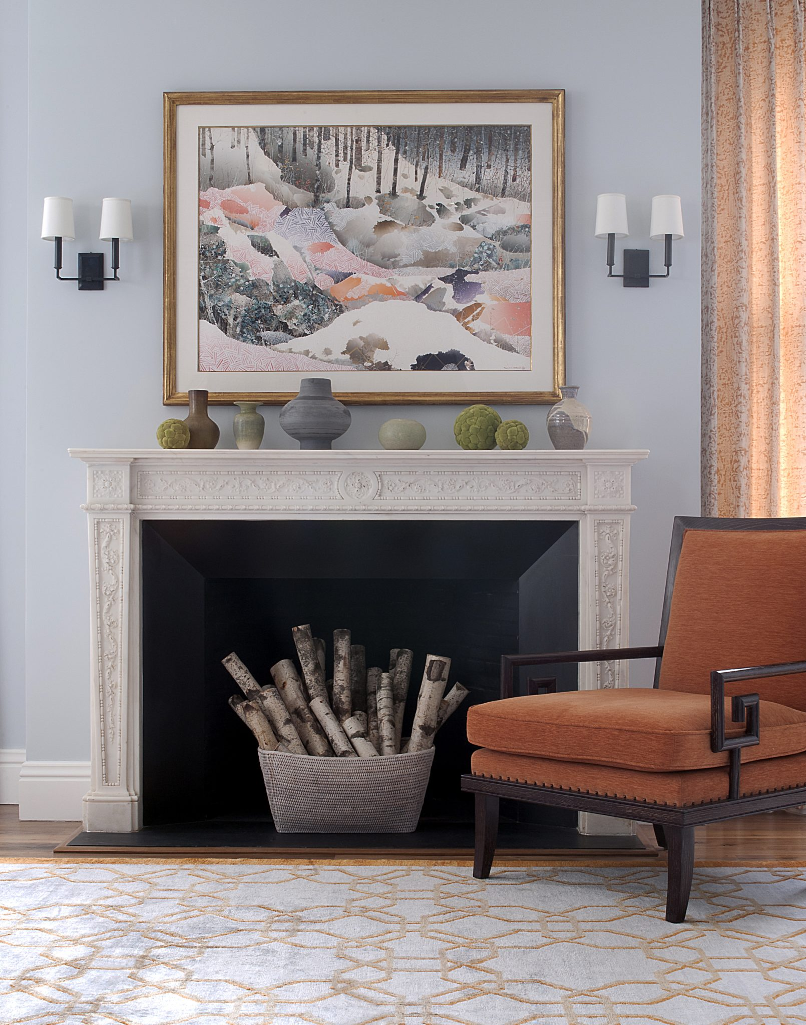 100-year old original mantel provides a dramatic focal point to the Living Room. by John Willey | Willey Design LLC