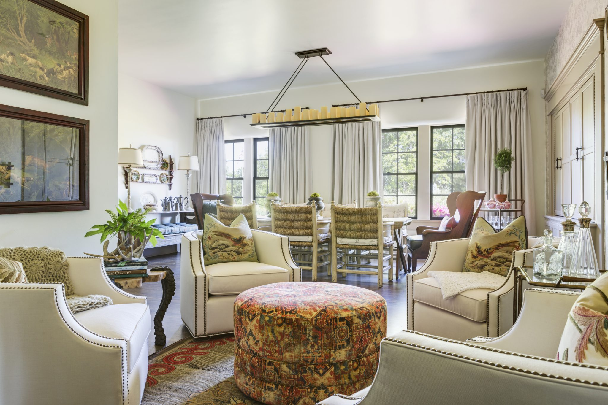 Sitting area with custom chairs, hunting prints and antique decanter collection by Goddard Design Group