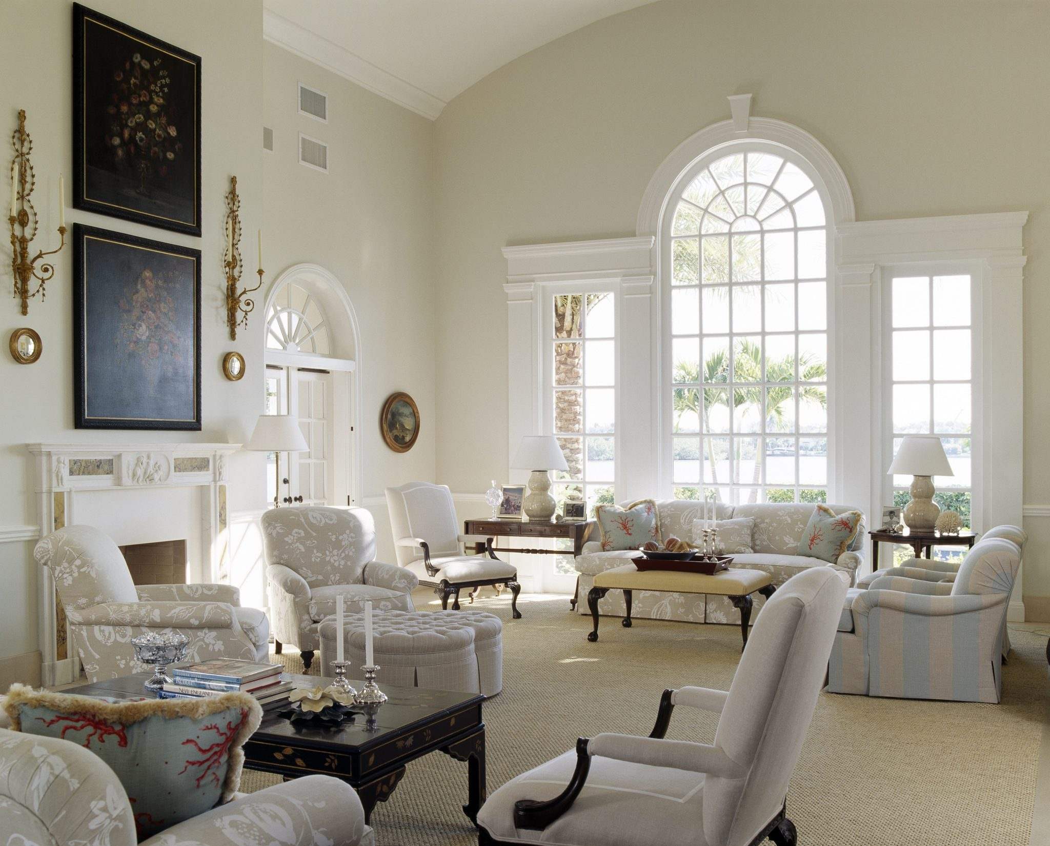 In this grand Vero Beach living room, design firm Gauthier~Stacy Inc. used linen fabrics and a sisal rug to relax the formality of the classical architecture. The window was left without drapery to allow natural light to stream in.