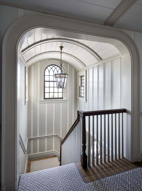 The stair rises within a dormer topped by an arched window featuring a Gothic fan light.