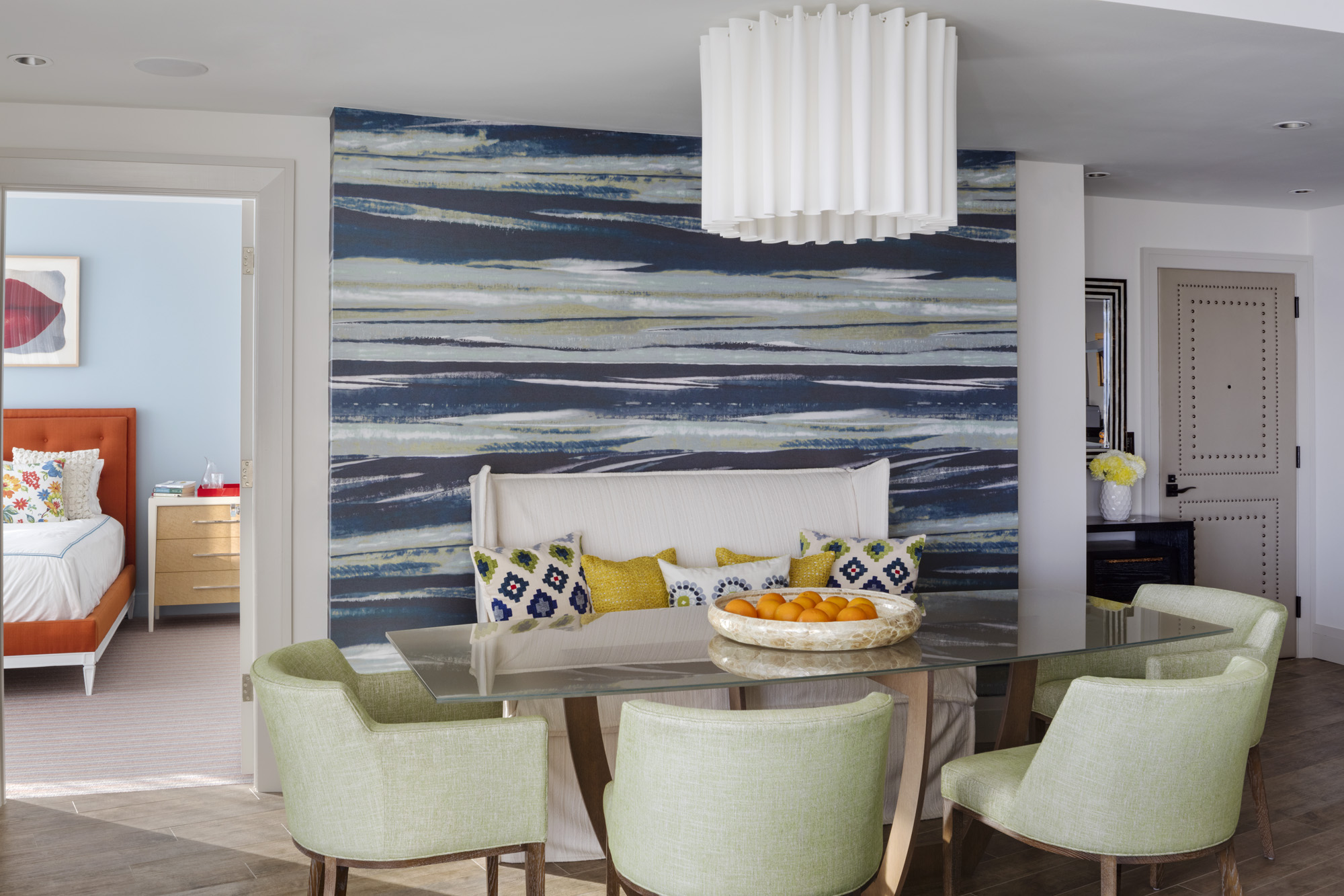 Boston-based LDa Architecture & Interiors used contemporary furnishings and vibrant color accents to update this beachfront vacation condo in Miami.