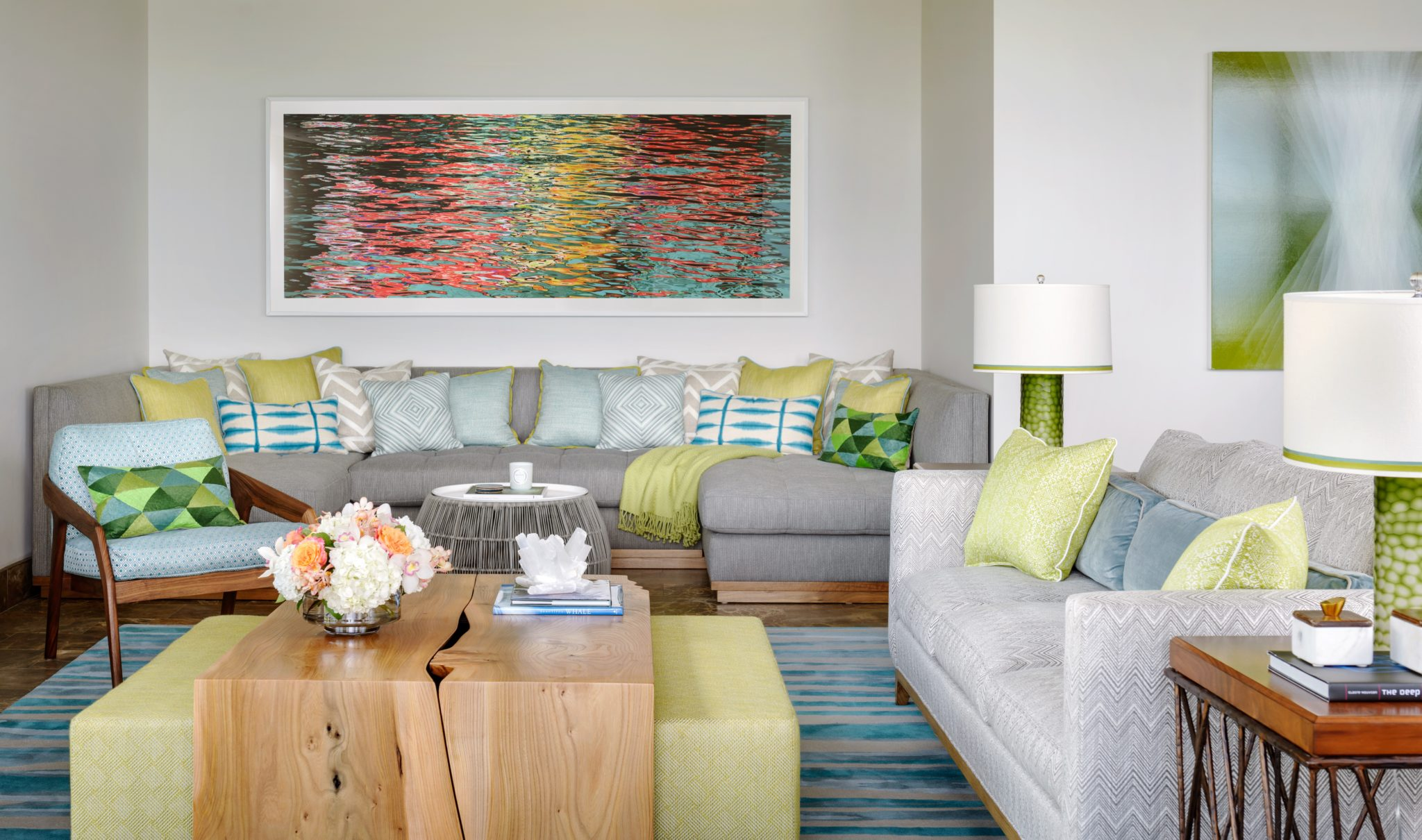 Hawaii Resort Living - Family room with custom built in sectional by Kelly Hohla Interiors