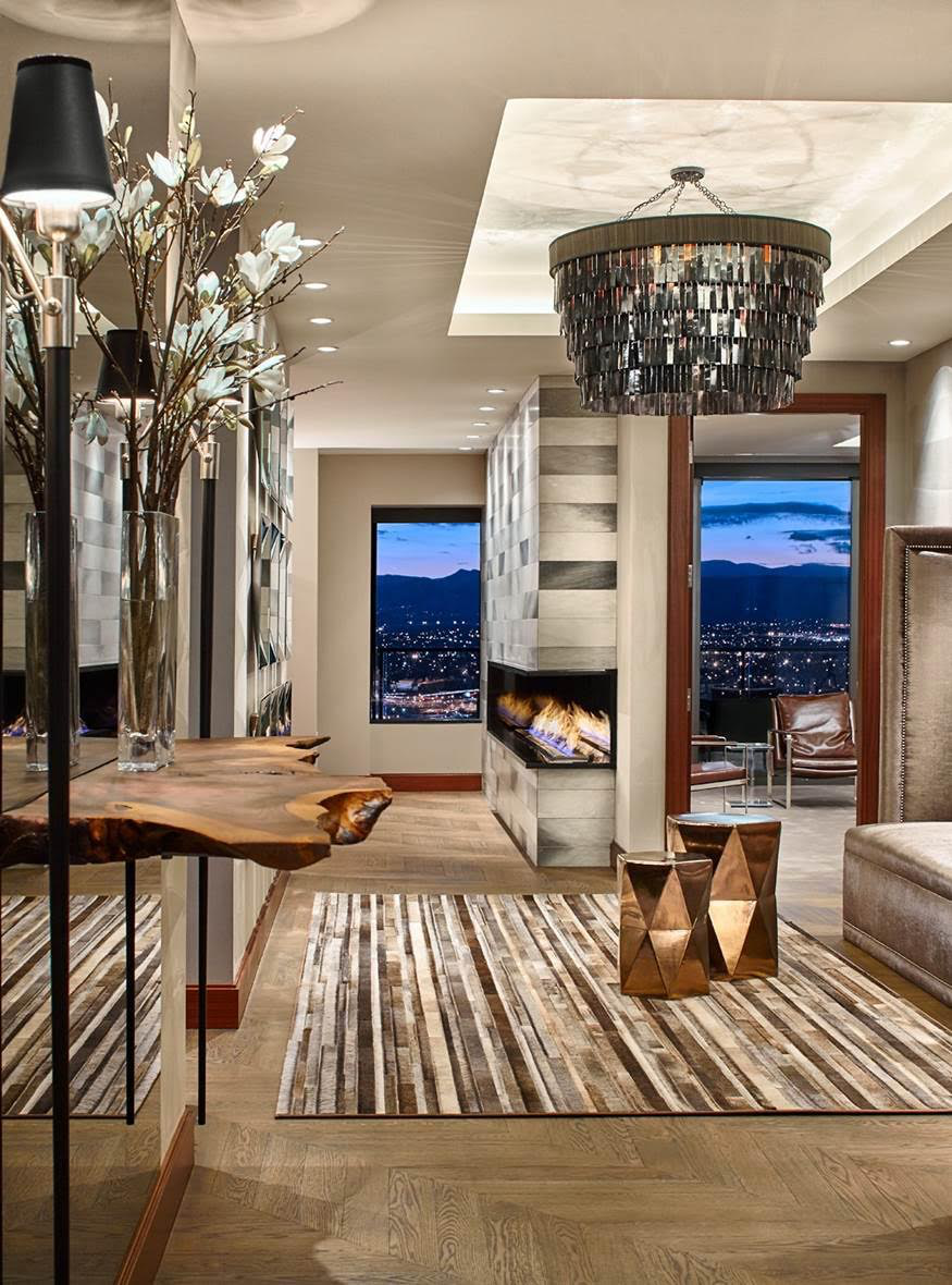"""Mistake #6: Lighting Fixtures That Are Too Small  """"One design mistake that I see quite often is the use of a chandelier that is under-scaled or too small for the space. It's necessary to consider the size of the room as well as the ceiling architecture when selecting a fixture. Avaulted or high ceiling, like the space above, will call for an even larger chandelier. I usually err on the side of selecting a fixture that runs the risk of being too large rather than too small.""""  David Hintgen, of DH Interiors"""
