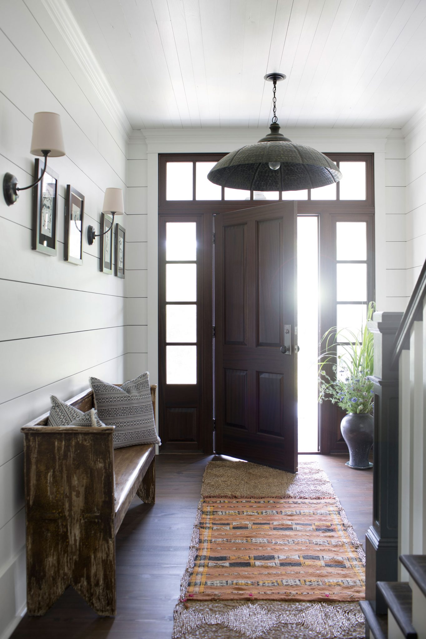 """Trend #5:Shiplap Paneling  """"Trends are something we actively work to avoid in design! But one design element that we've always loved and probably will forevermore is shiplap. It can be used to add infinite interest to otherwise plain jane walls, and it works just as well in a casual country dwelling as it does in a modern, sophisticated city home.""""  -Krista Nye Schwartz & Tami Ramsay, CLOTH & KIND  Photography by Sarah Dorio"""