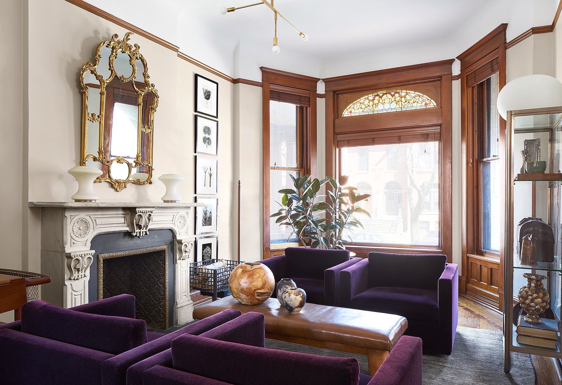 Chicago. Neoclassical living area with original marble fireplace & stained glass by Studio 6F