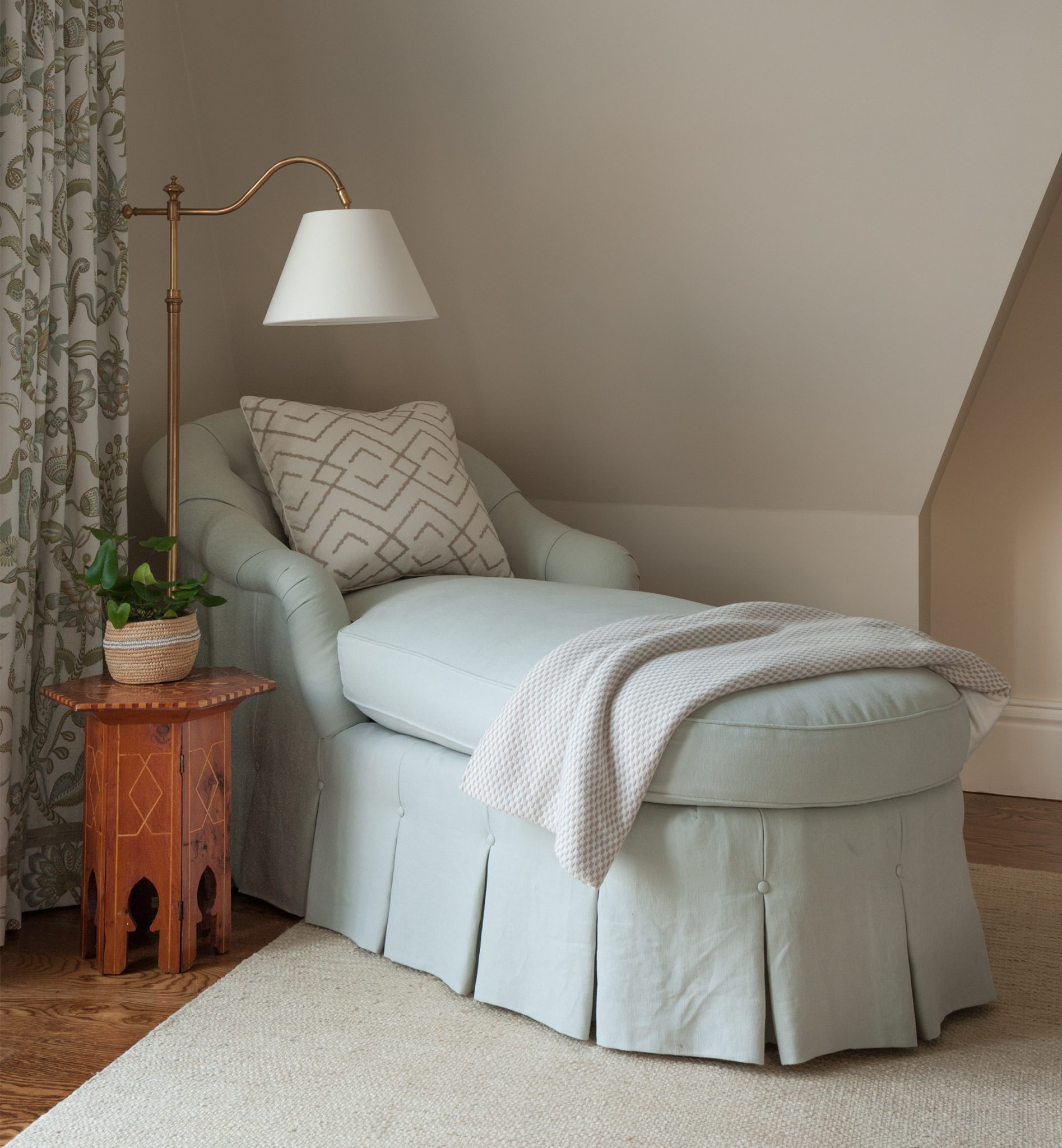 Master bedroom with an upholstered chaise and vintage inlaid side table by Liliane Hart Interiors