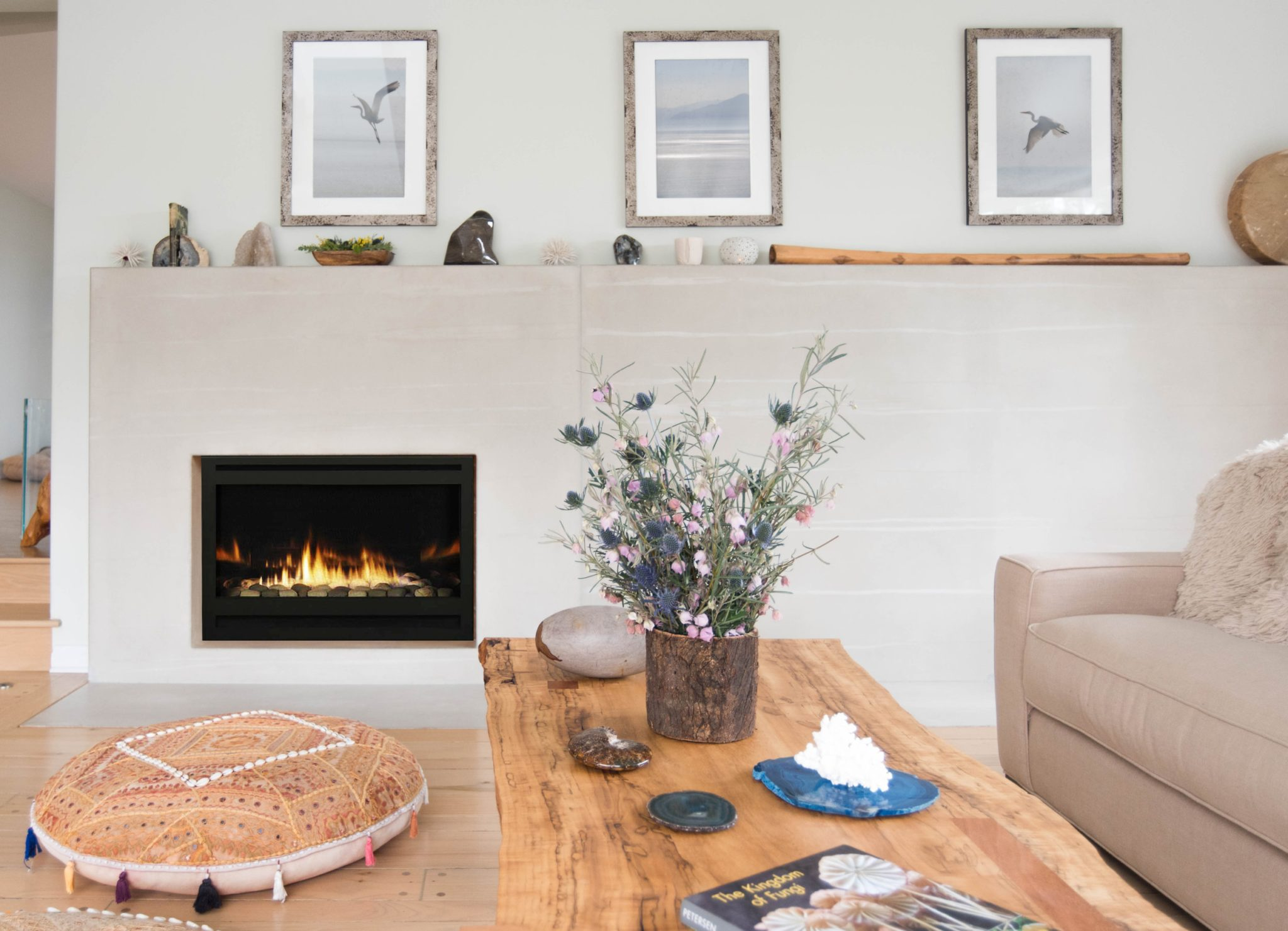 This custom fireplace designed by Sarah Barnard displays mineral specimens. by Sarah Barnard Design