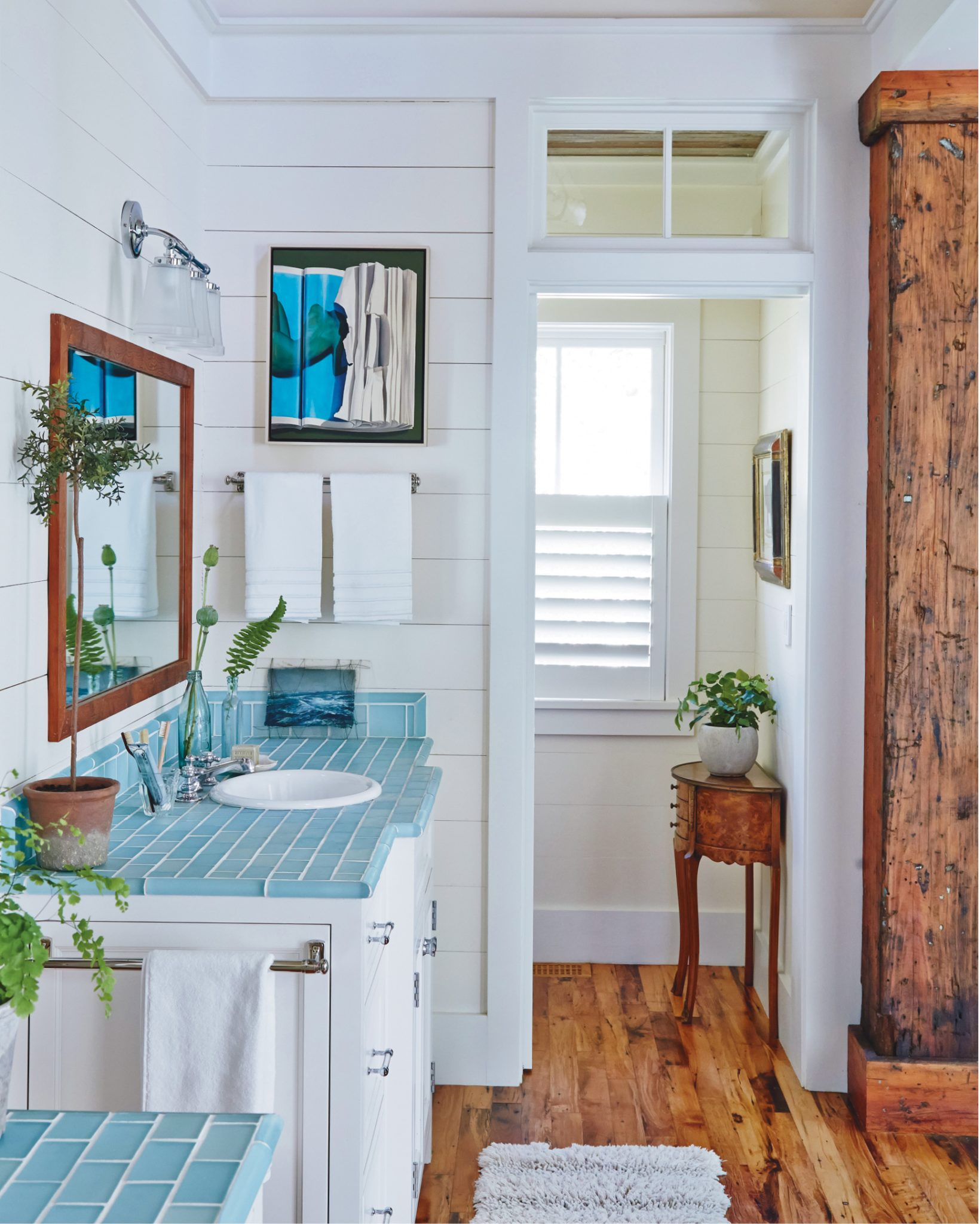 White Shiplap walls, heart of pine flooring and pastel subway tile by J Banks Design