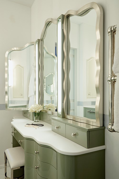 """Trend #7:Polished Surfaces & Neutral Colors  """"With the weathered industrial look in the rearview mirror, I find that we are seeing a lot more polished surfaces and lighter neutrals.This includes high gloss or lacquered pieces and creams and sunny colors that evoke a more streamlined feeling. In this bathroom, ahigh polished finish on the cabinetry is paired with light colors to achieve a classic but contemporary feel.""""  Brooke Moorhead, of Brooke Moorhead Design"""