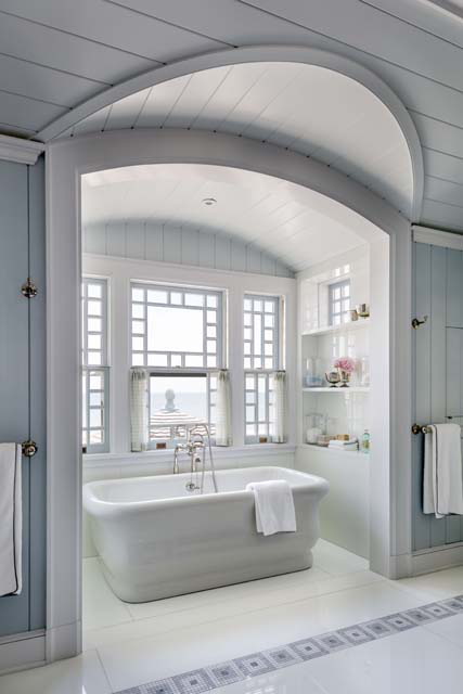 The tub sits in an alcove with a view over the dining room porch roof.