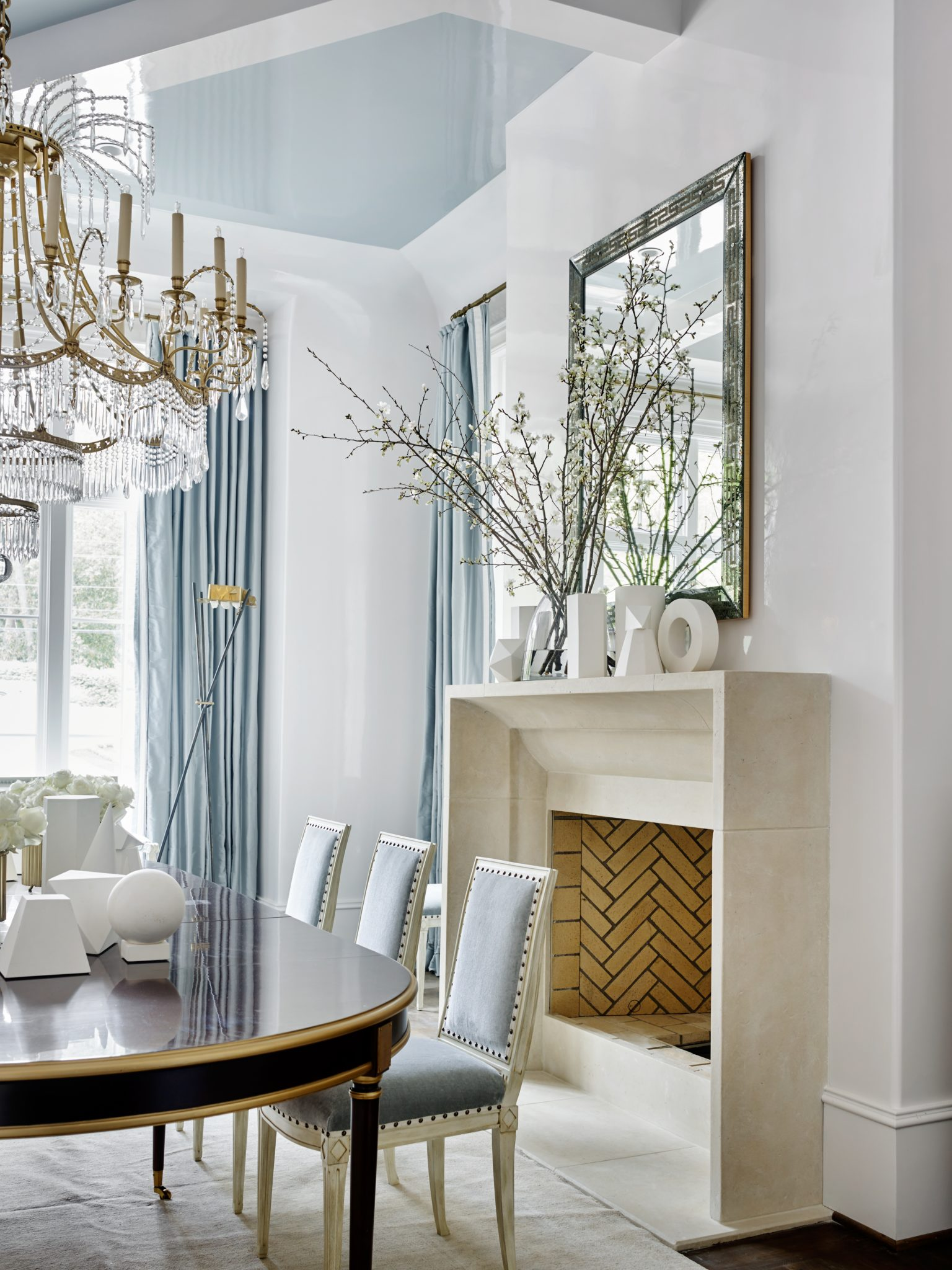 Southeastern Showhouse dining room with fireplace by Suzanne Kasler Interiors