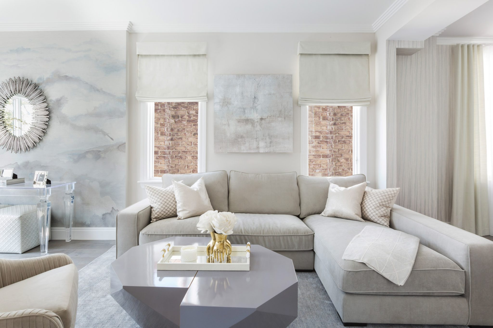 Contemporary grey and beige living room with a sectional by Vi Design