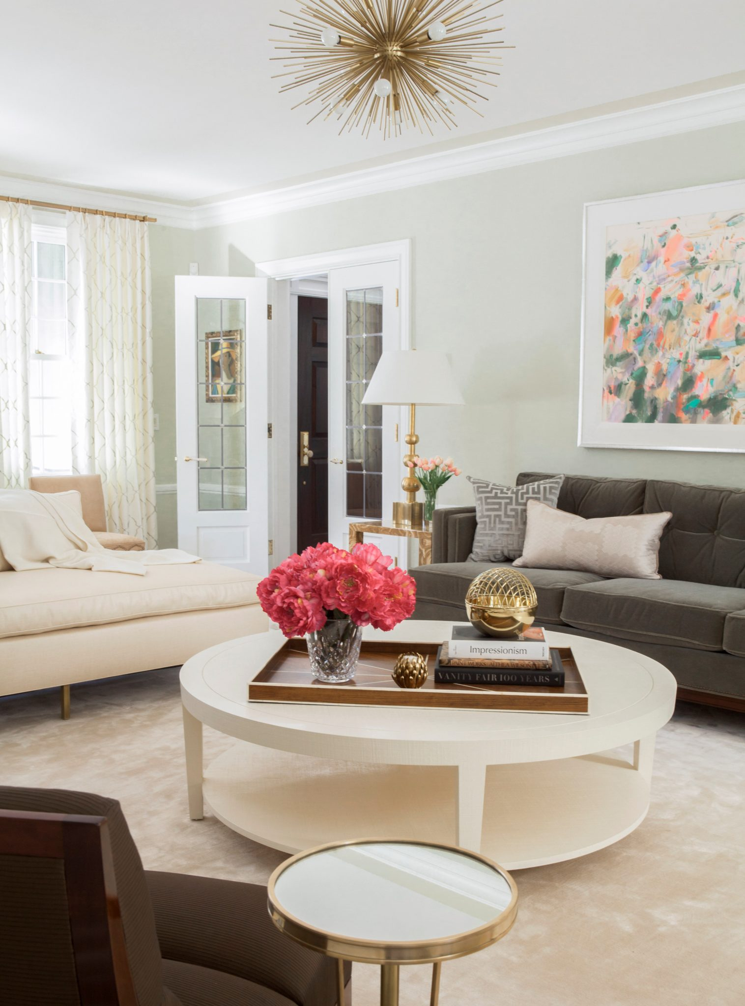 Pastel living room with Sputnik-style chandelier by S.B. Long Interiors