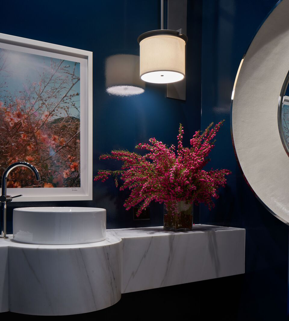 This bold color and sink assures that the powder room is not an afterthought. by Marcus Mohon Interiors