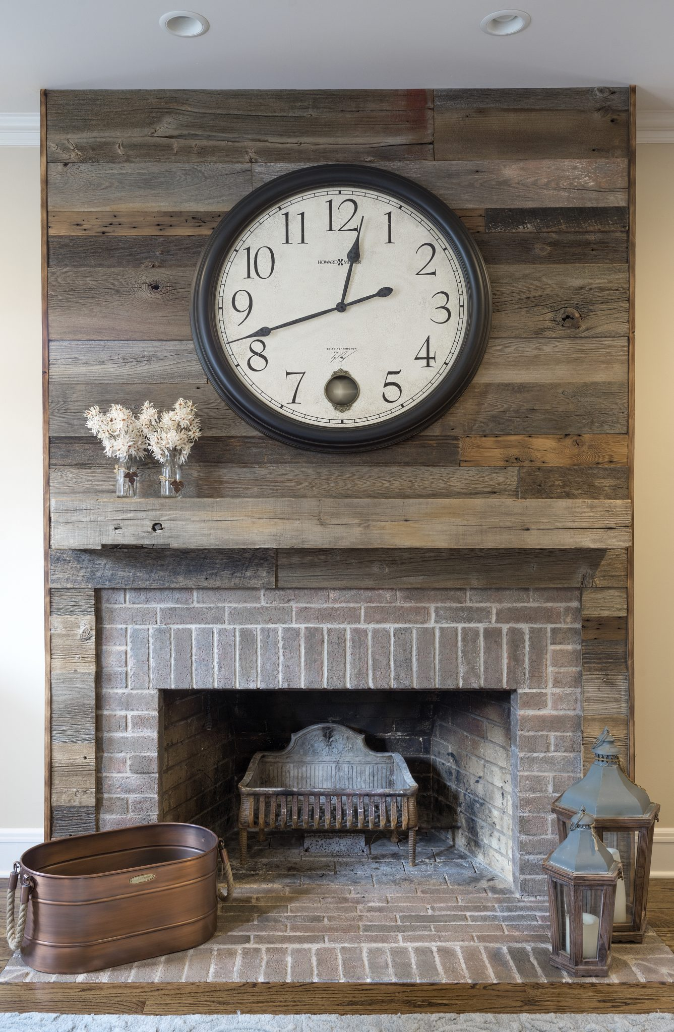 Fireplace with reclaimed shiplap by Kristin Petro Interiors, Inc.