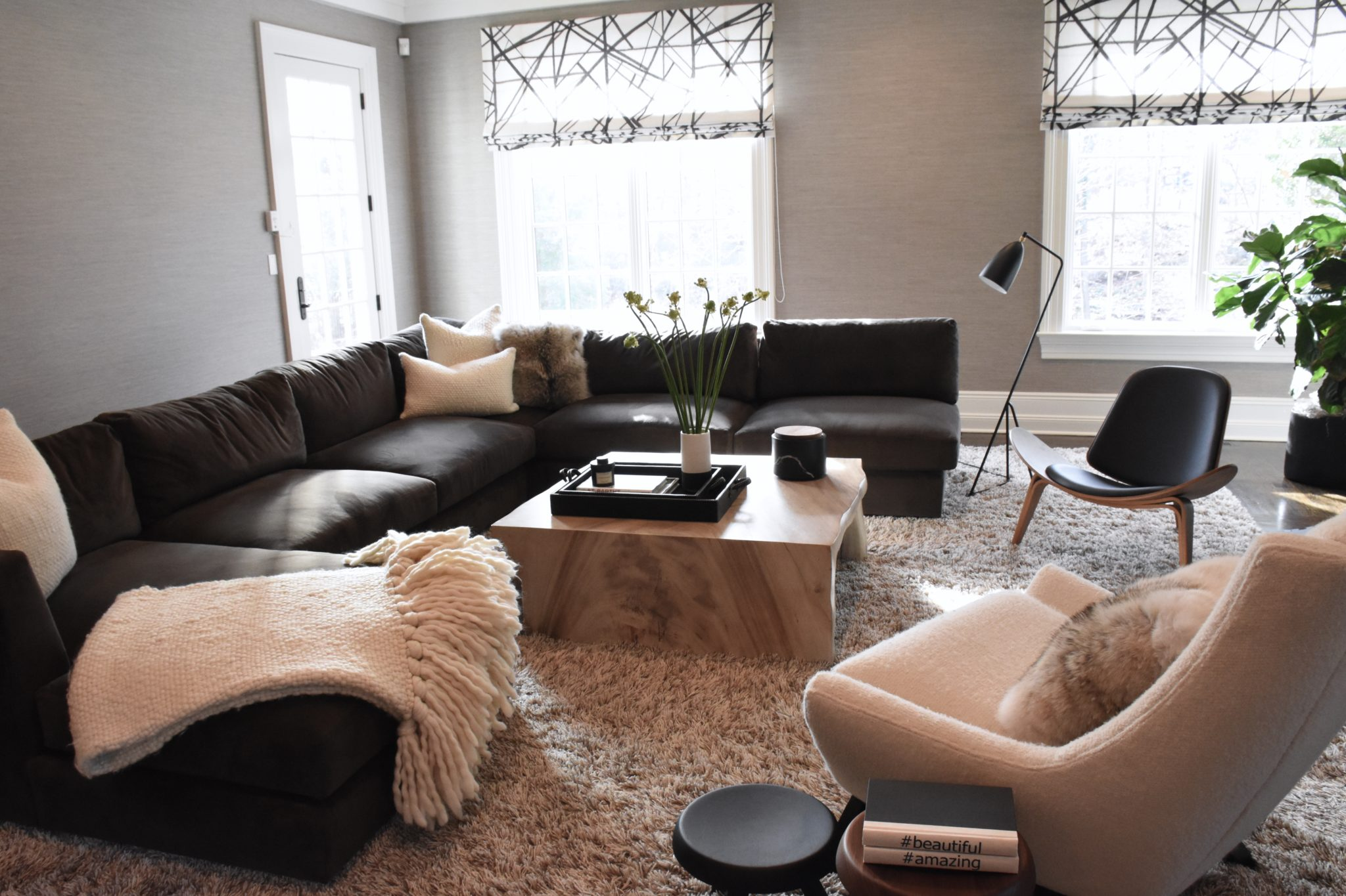 Comfy family room with sectional and plush rug by Monica Fried Design