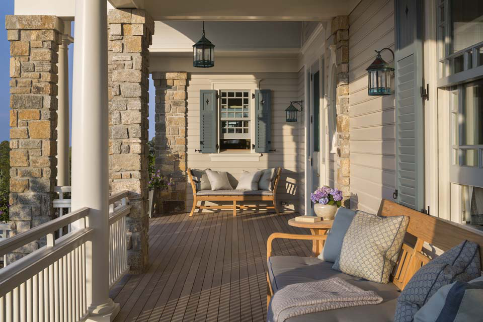 The entry porch, looking toward the library window. The joints of the stone piers, handrails and clapboard provide an ever-changing play of shadows.