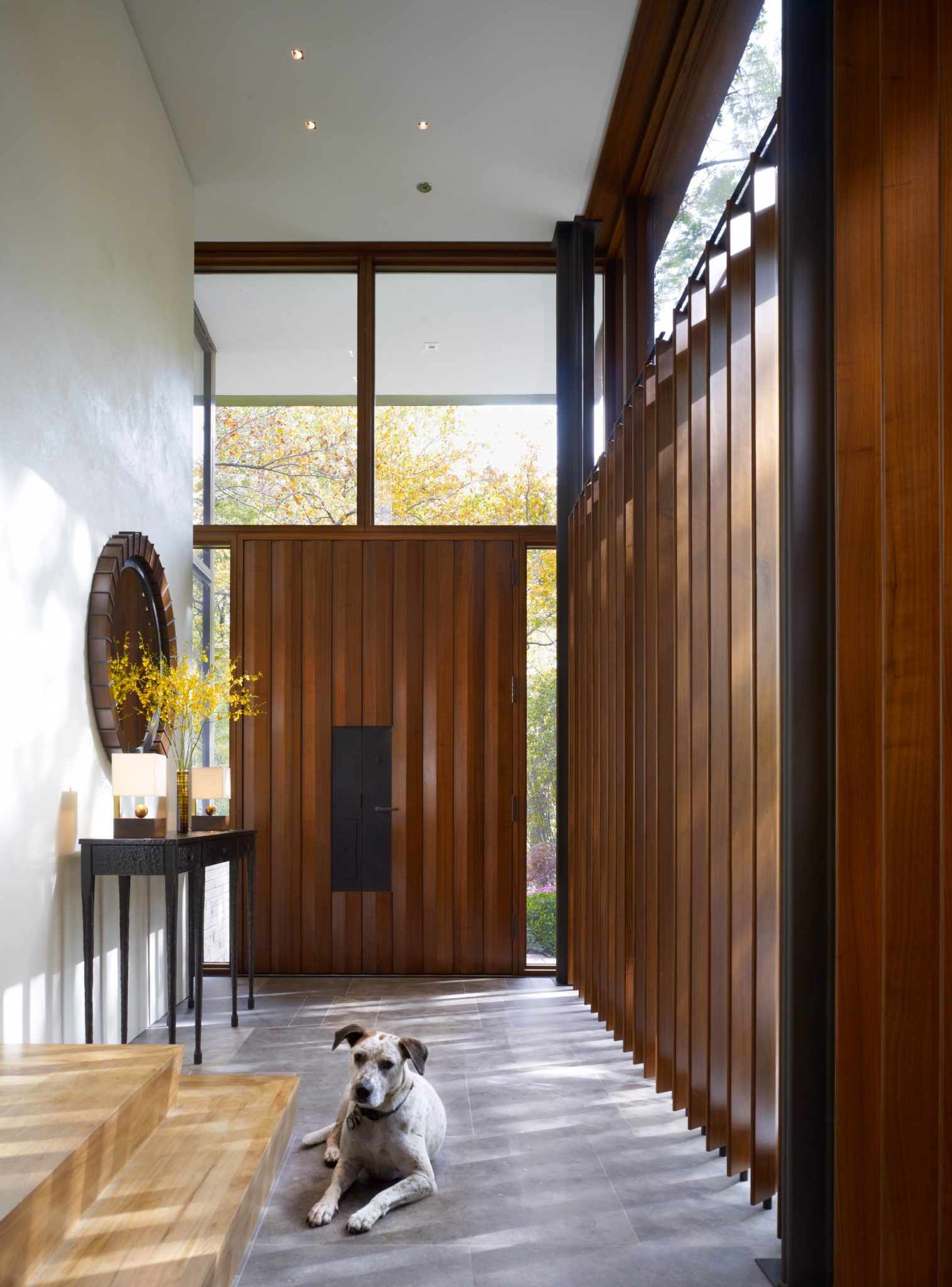 Lake Shore Foyer, Custom Louvers, Hammered metal console, Custom Mirror Cute Dog by Rariden Schumacher Mio & Co.
