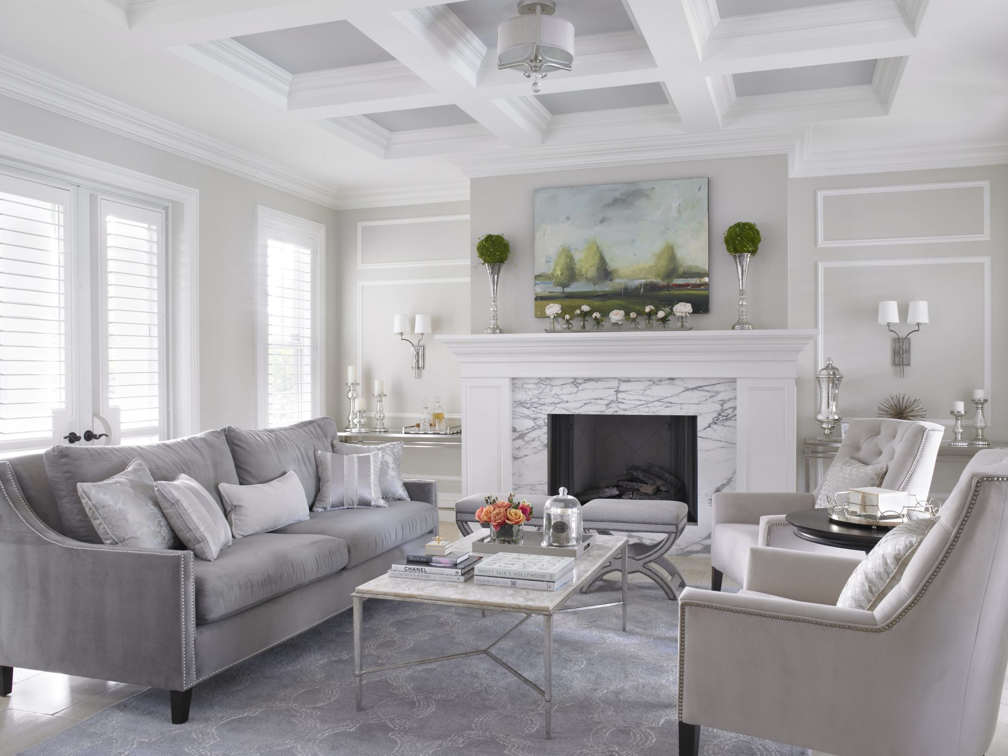 Chic monochromatic grey living room with custom ceiling & detail fireplace. by Jaime Blomquist Interiors