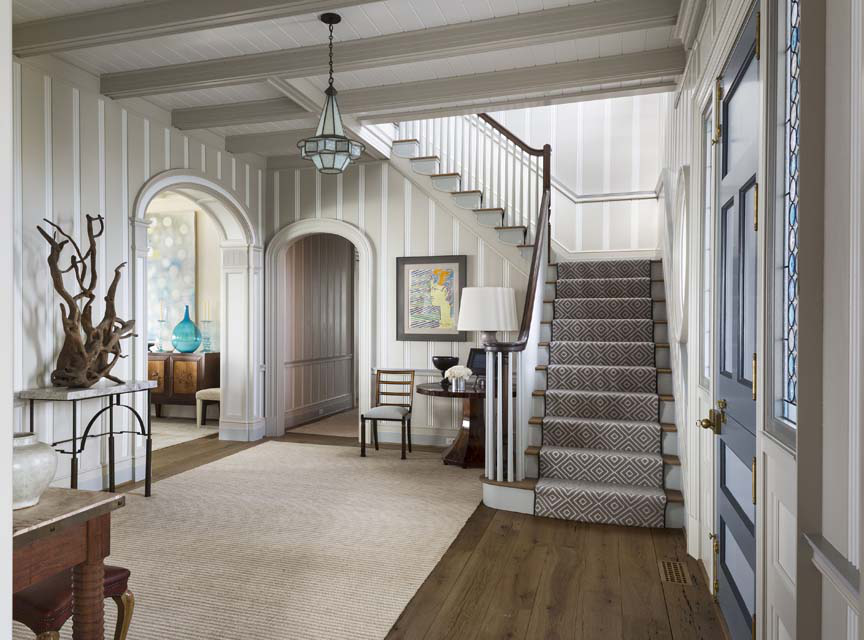 In the entry hall, to the left of the main stair the large arched opening connects to the dining room.
