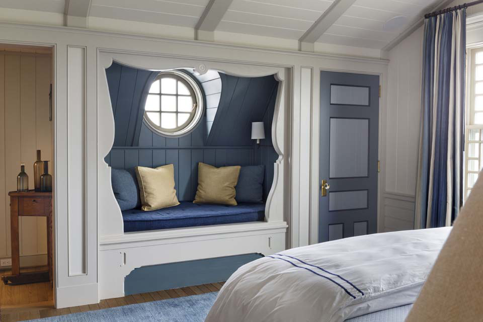 The playful swag detail, which gives the banquette alcove the flavor of a proscenium, draws on a Swedish precedent.