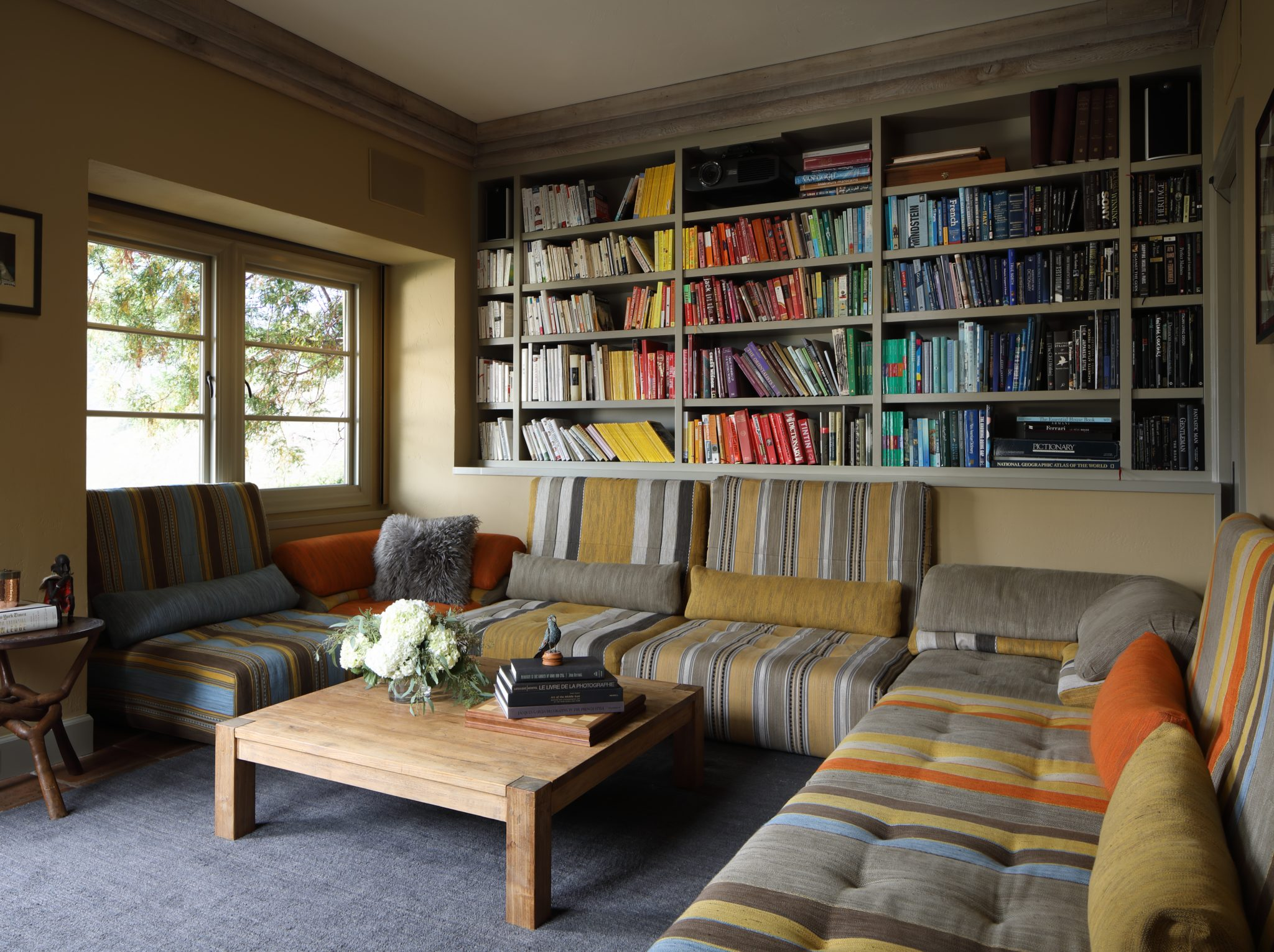 Custom Bookcase with Roche Bobois sectional by Maria Haidamus Interiors