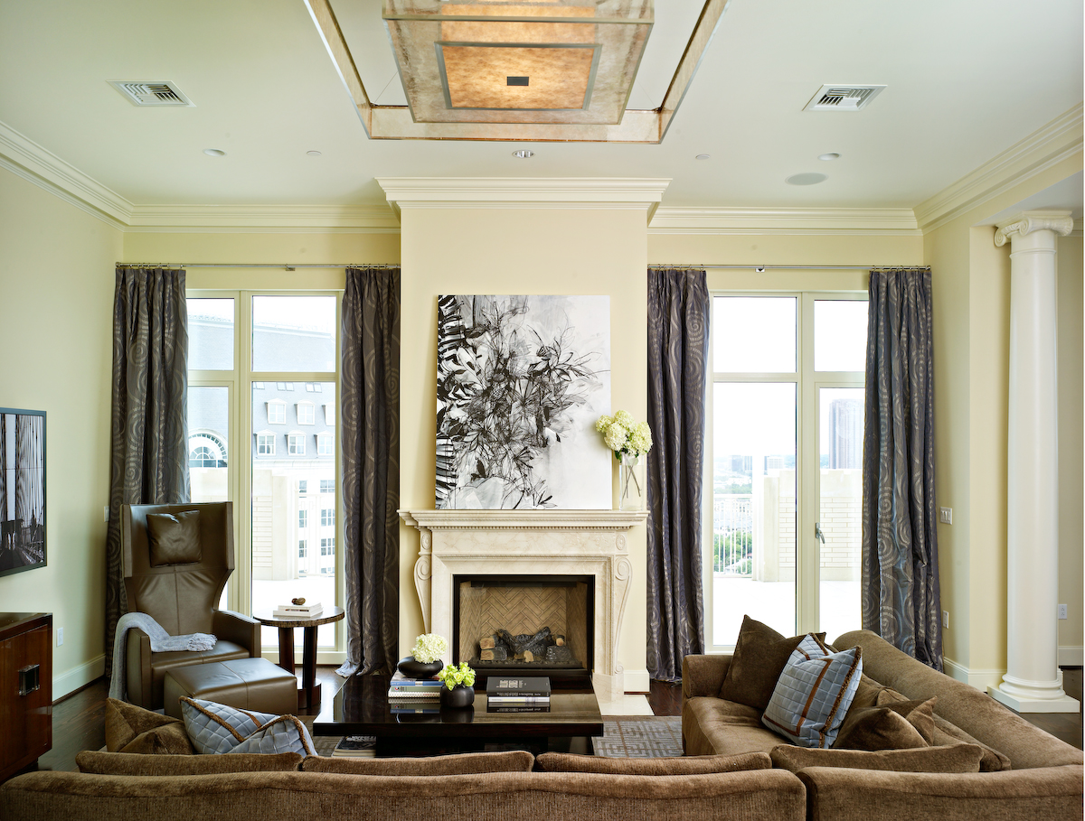 This interior blends multiple seating areas, contemporary furniture and a restrained color palette, creating a backdrop for relaxing at home or entertaining friends with various activities. By Sherry Hayslip Interiors & Hayslip Design Associates, Inc.