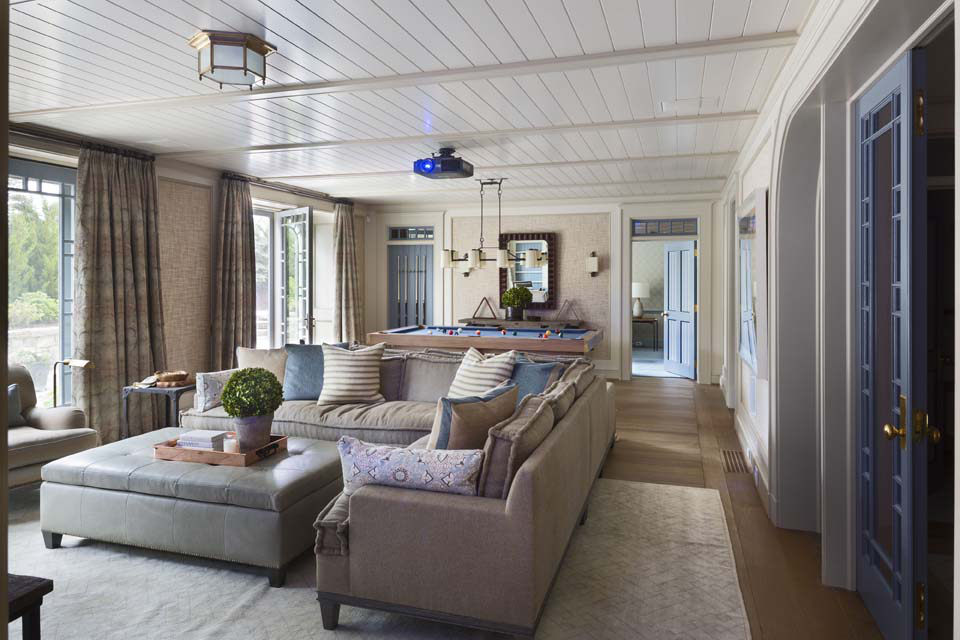 The ground-level Summer Room, which opens to the side garden, serves as a game and media room and as a casual communal space for the bedrooms that open to it.