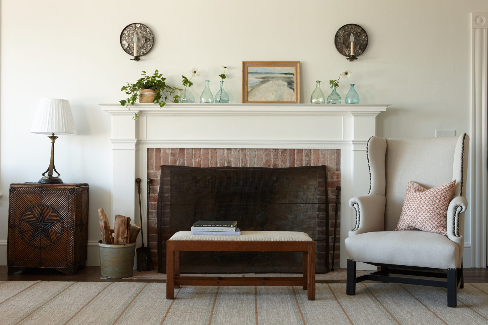 View of a fireplace in a living room. by Liliane Hart Interiors