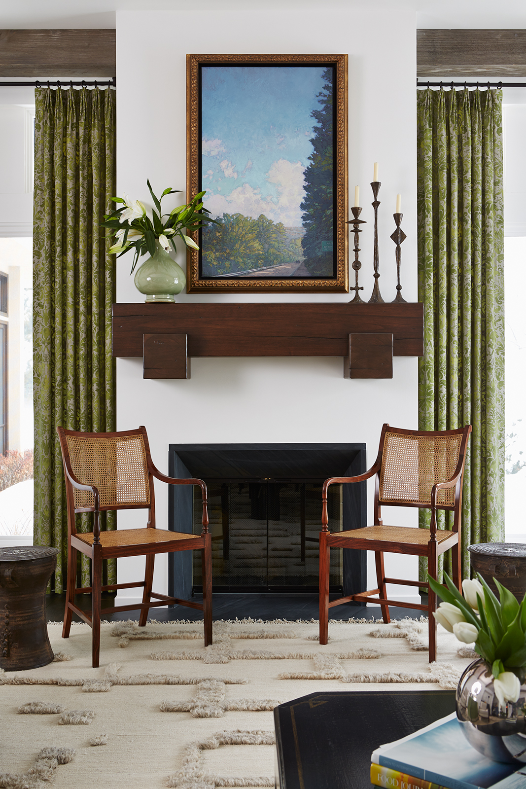 A sophisticated living room featuring green drapery by Andrew Flesher