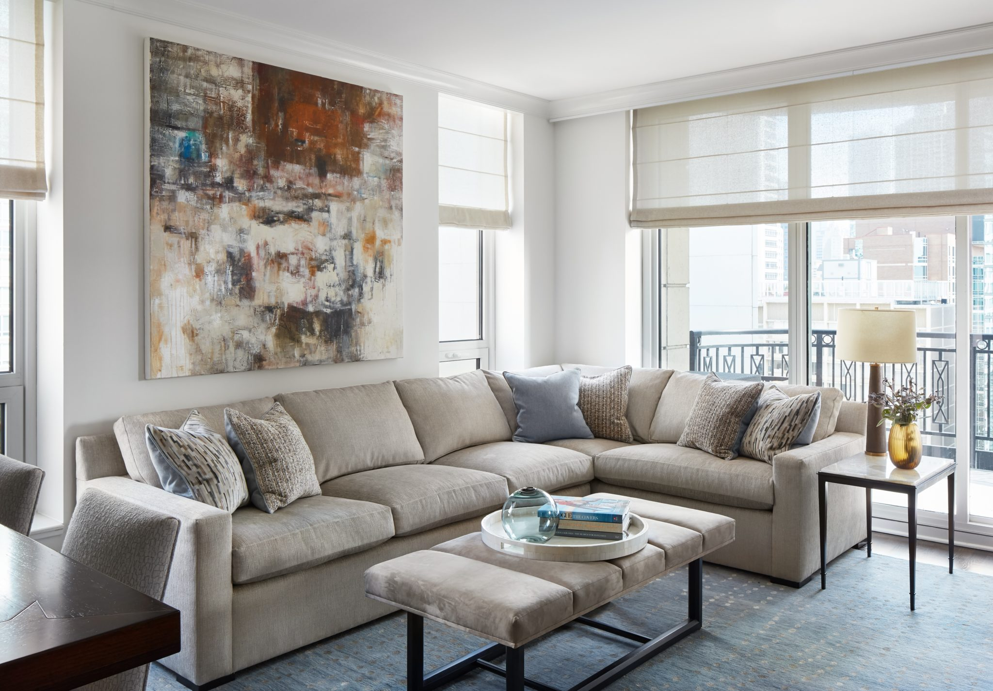 Well Read | Custom Sectional and Channeled Ottoman by Laurie Demetrio Interiors