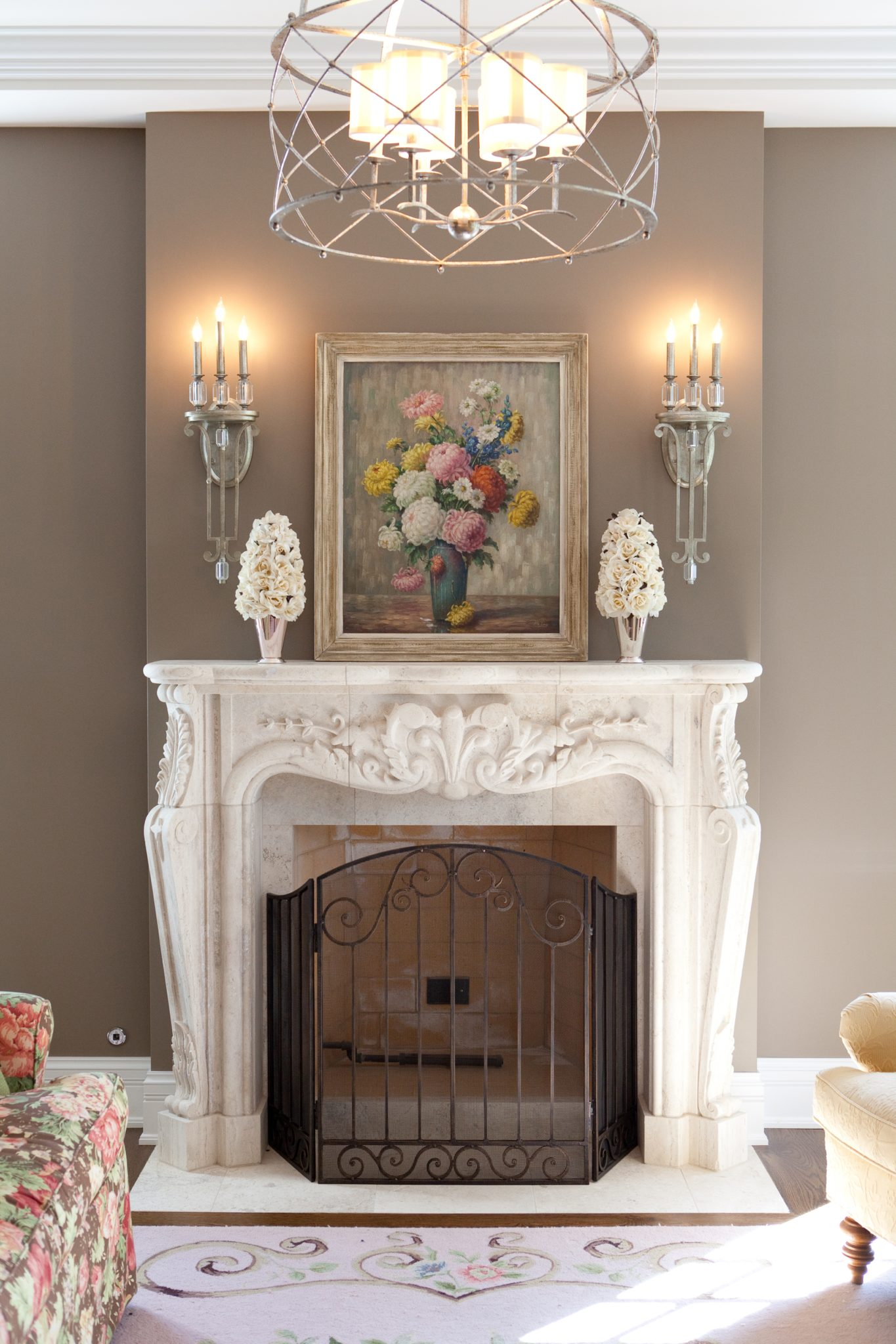 Elegance and symmetry defines a traditional fireplace vignette. by Michelle's Interiors