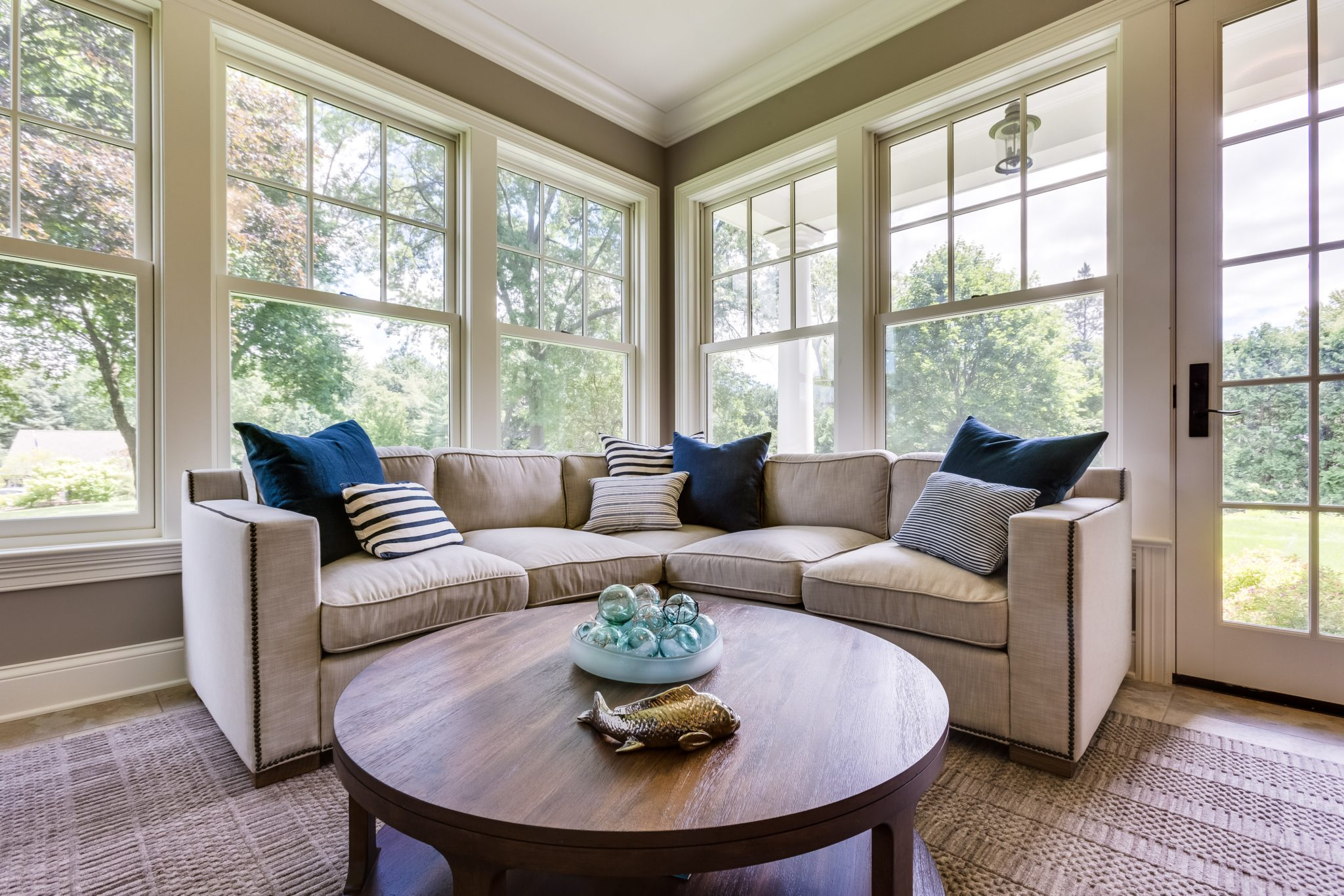 Inverness Estate, Sunroom with beige sectional and blue throw pillows by Rae Duncan Interior Design