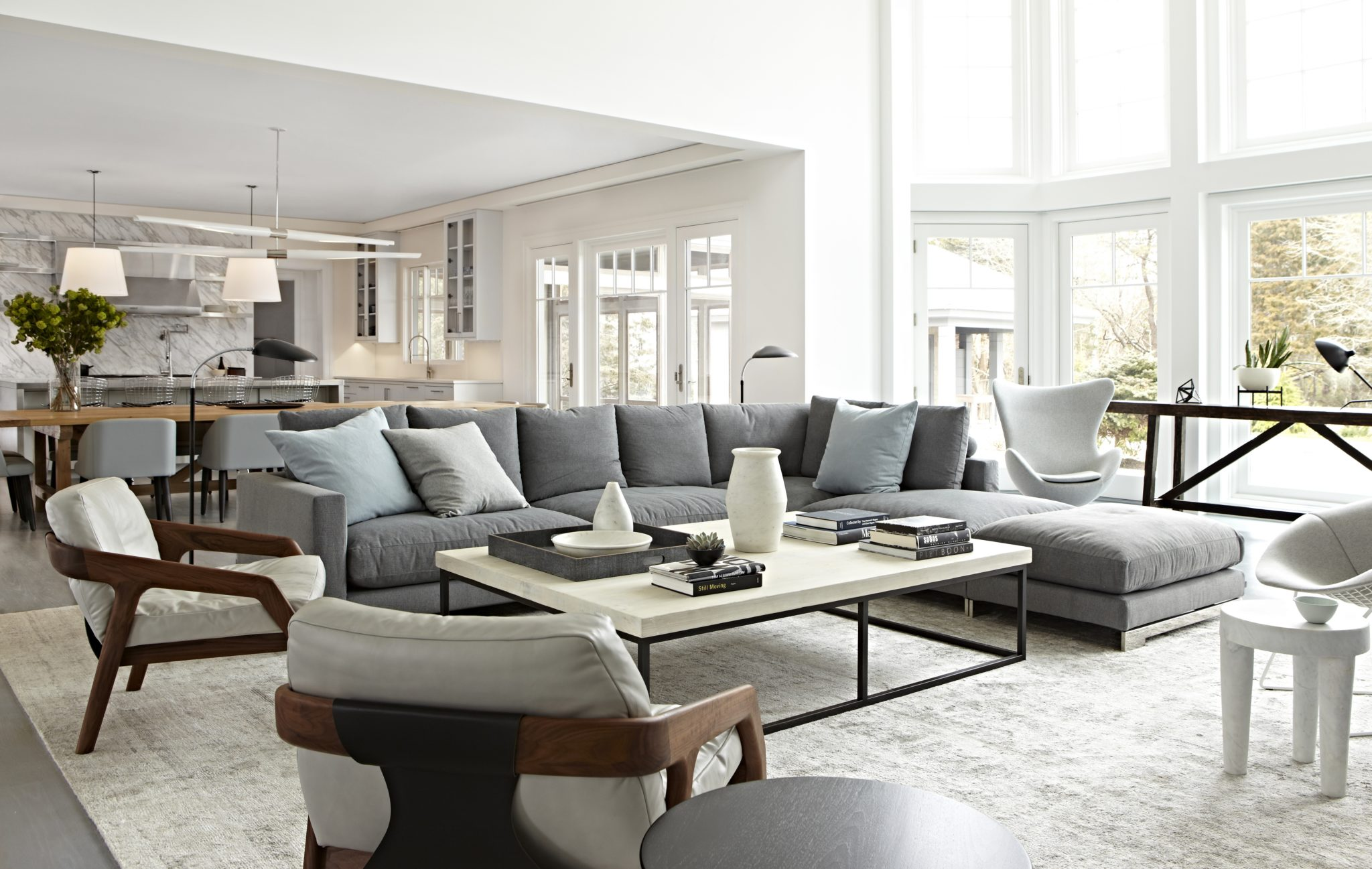 Quogue, Hamptons large living room with sectional seating. by Tina Ramchandani Creative