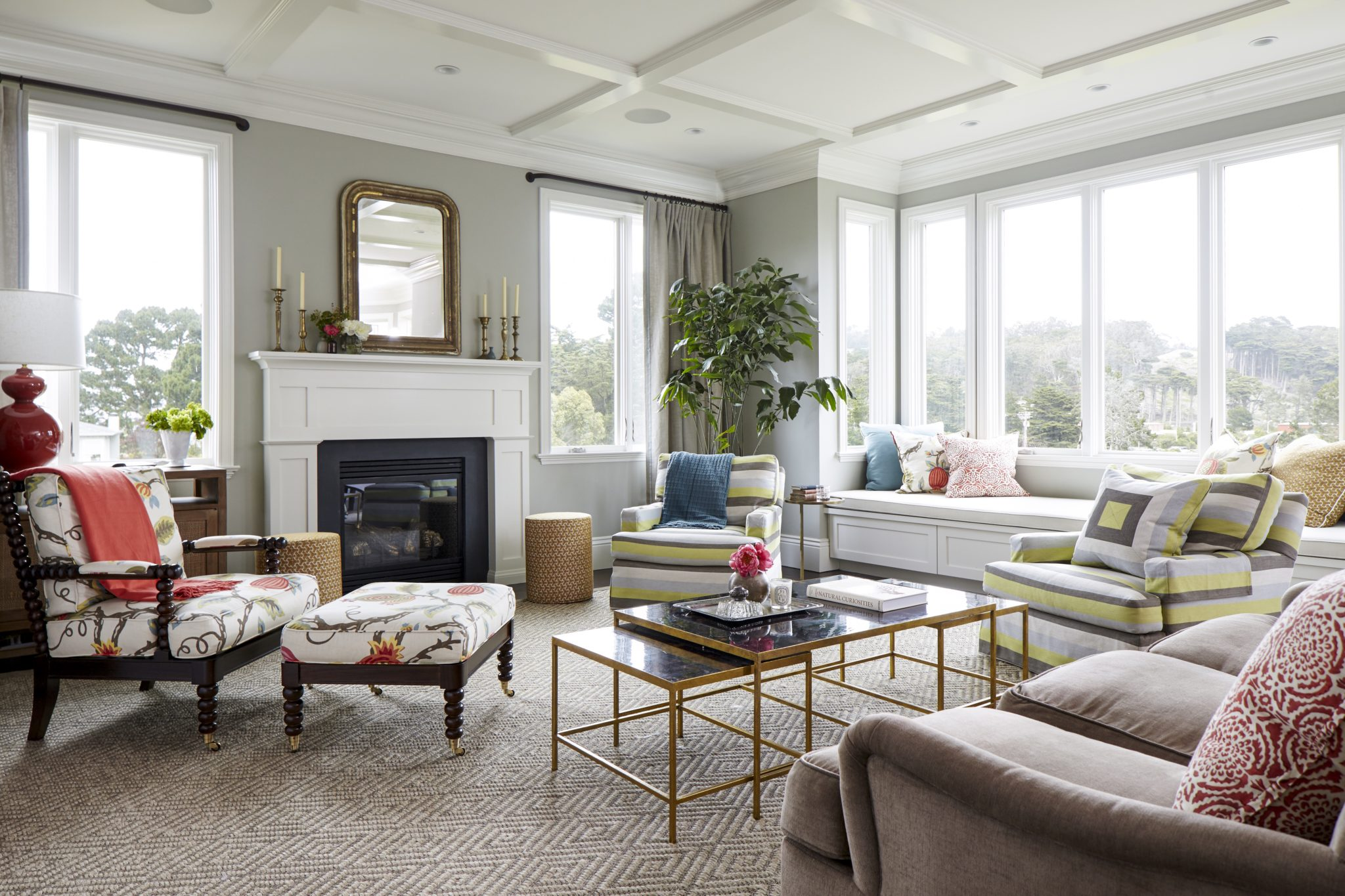 Living Room with Coffered Ceiling and Fireplace by Jeff King & Company