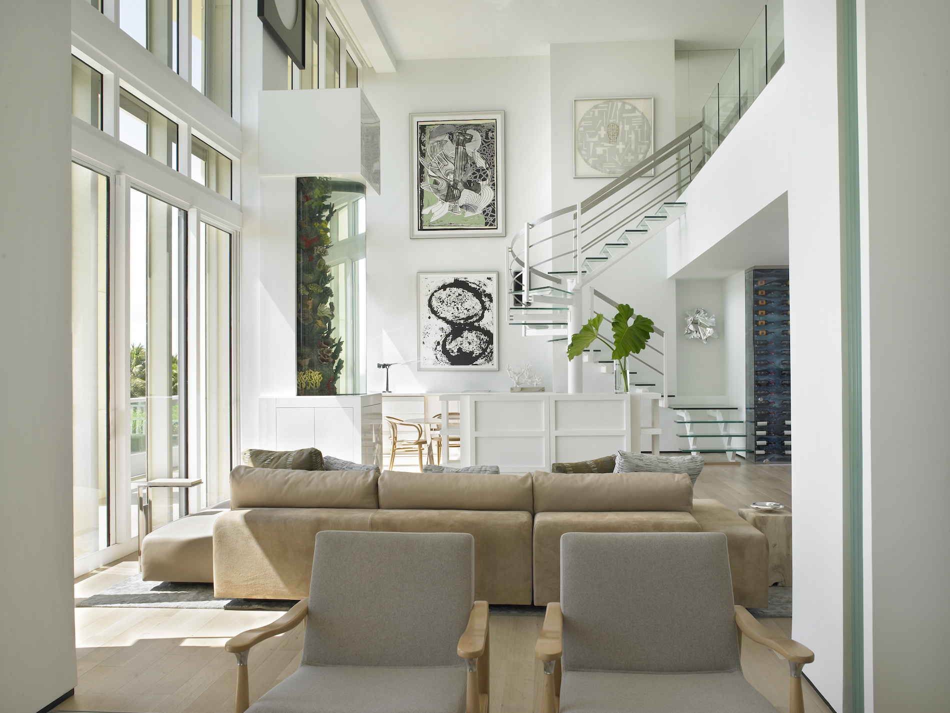 This modern home designed by Michael Wolk is located directly on Miami Beach. The open, double-height living room takes advantage of the enviable ocean views and highlights the owner's impressive art collection.