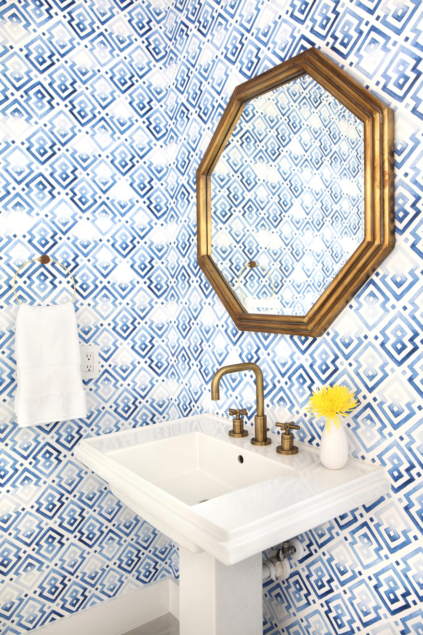 Powder Bath with graphic wallpaper and brass accents by Sarah Wittenbraker Design