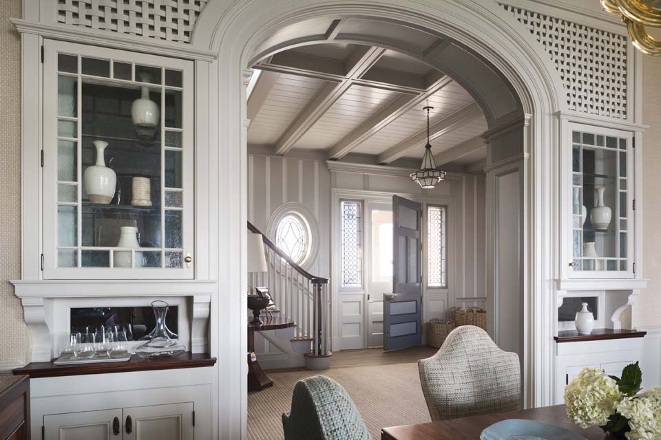 The design of the dining room buffet draws on the treatment of the windows and its woven trellises.
