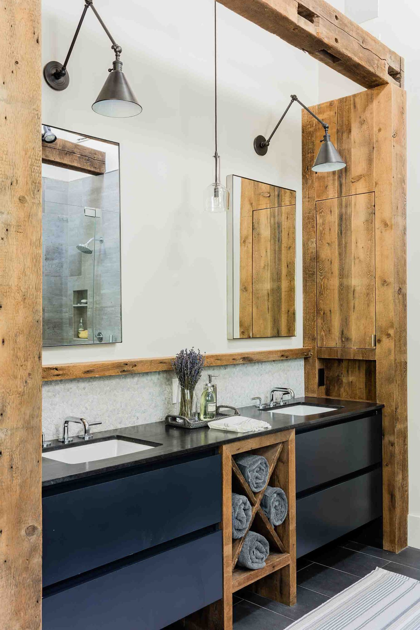 Rustic bathroom with wood beams and dark vanity by Jennifer Palumbo Inc.