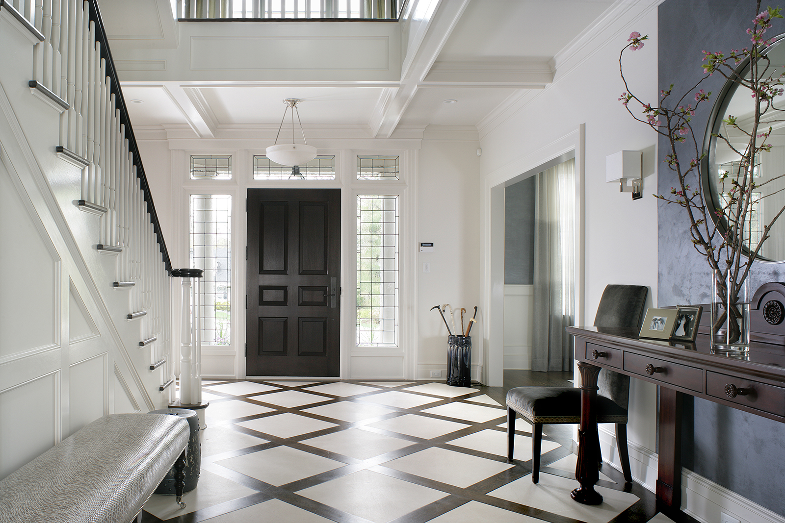 Entrance Foyer with custom limestone inlaid floor design by Valerie Grant Interiors