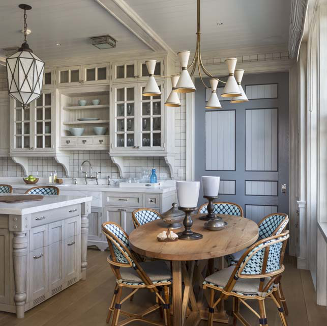 The soft grey hand-painted finish on the cabinets and glazed wall tiles evoke seashells and driftwood.