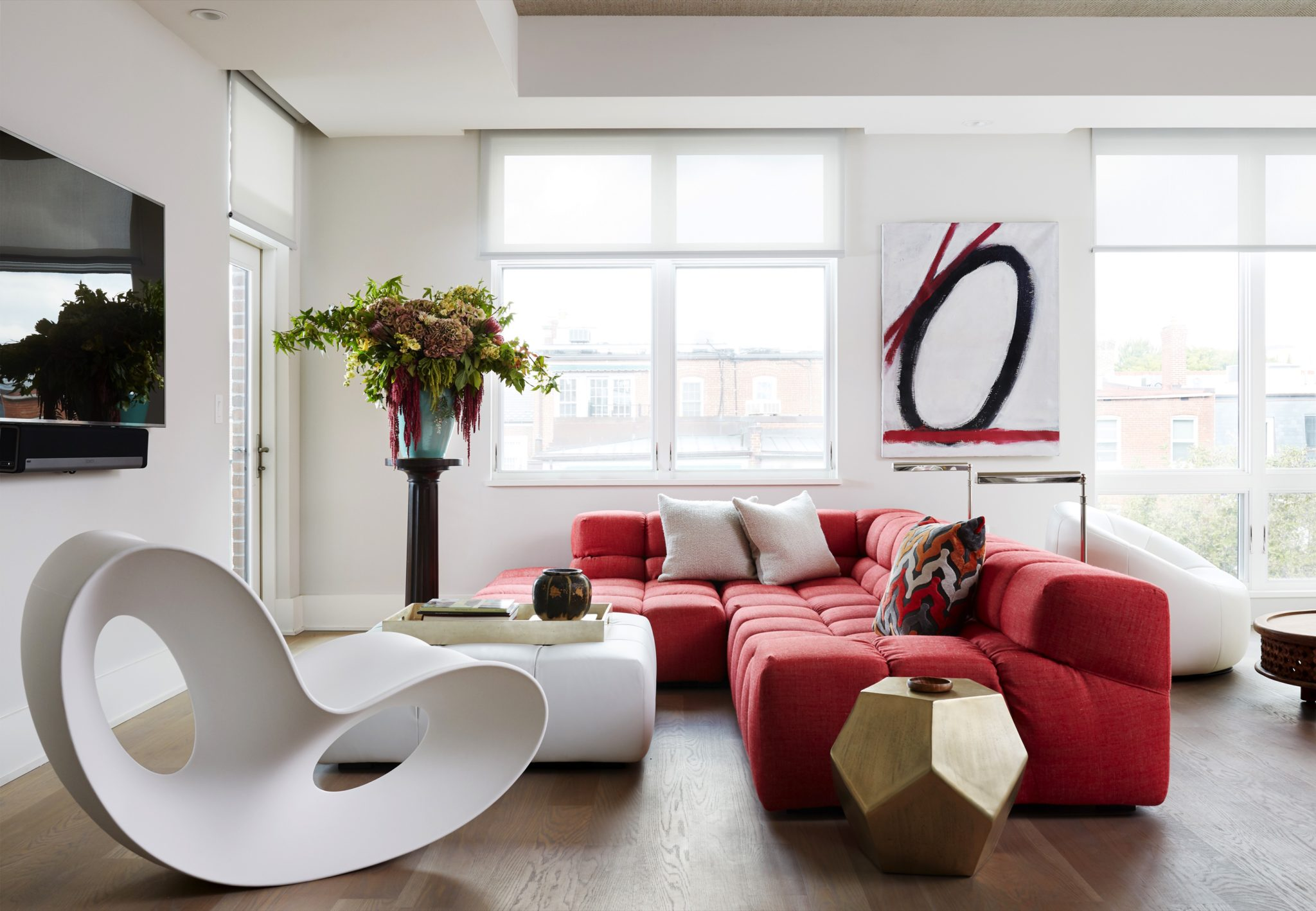 Sleek, white living room bright red sectional rocking chair contemporary seating by Dane Austin Design