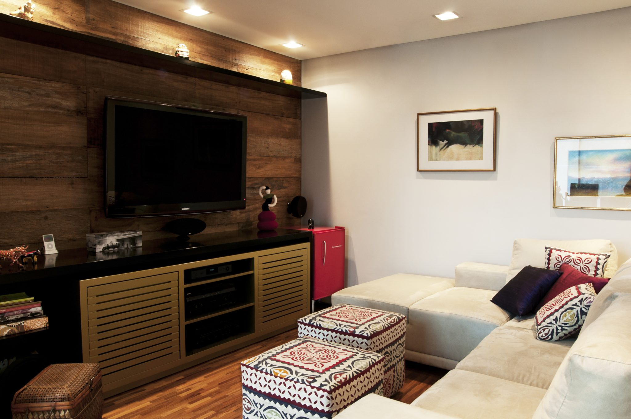 Eclectic family room with custom wood paneling and millwork by We Bossa