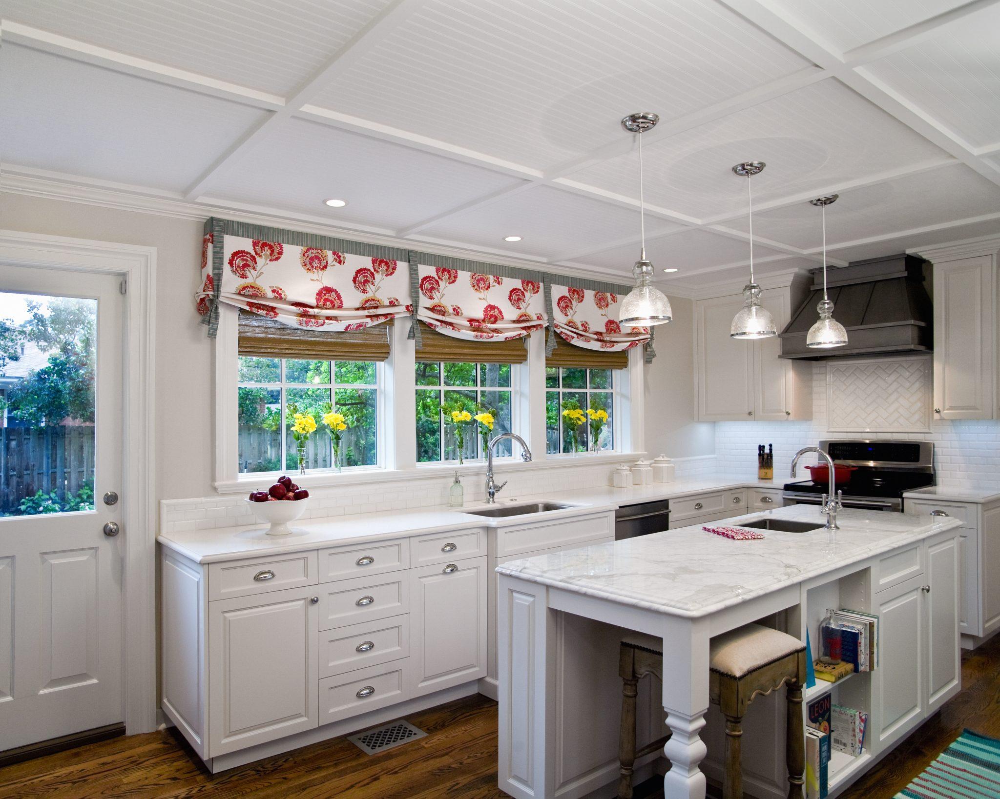 An all-white cottage kitchenby Studio M Interior Design