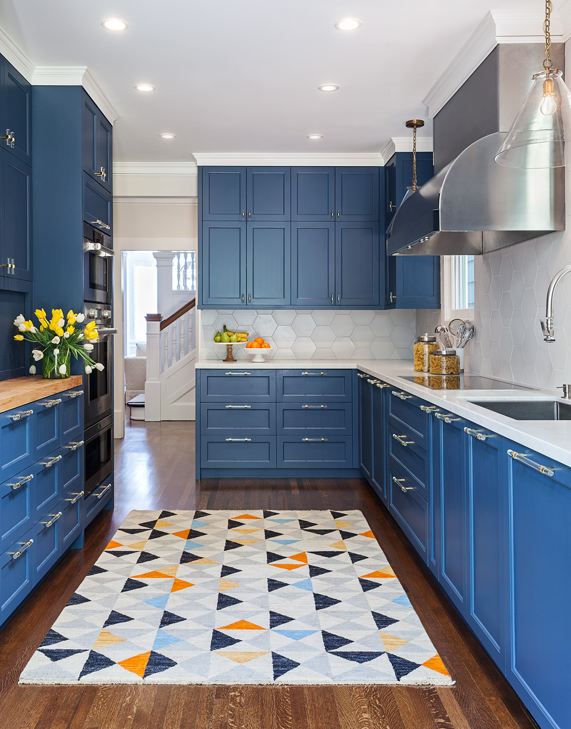 Colorful Galley Kitchen with Glass Pendants in Pacific Heights Home by Marsh & Clark Design