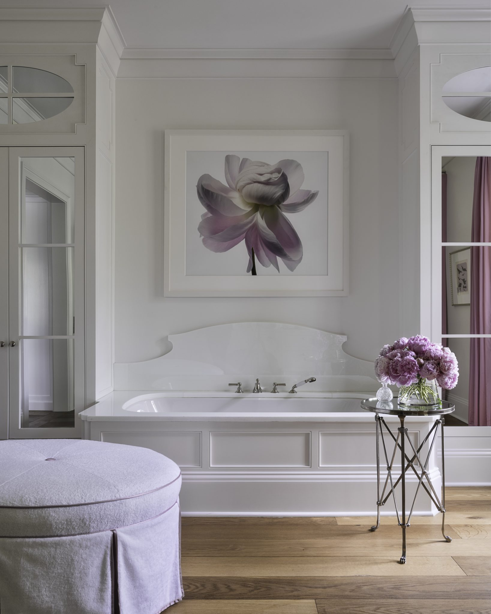 Glamour bath with wood floors and soft colors by Suzanne Kasler Interiors
