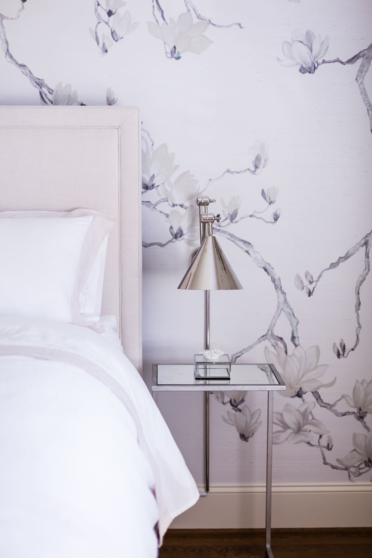 Floral, Feminine Wallpaper Accent Wall, and Polished Nickel Sconces bedside. by Colorful Concepts Interior Design