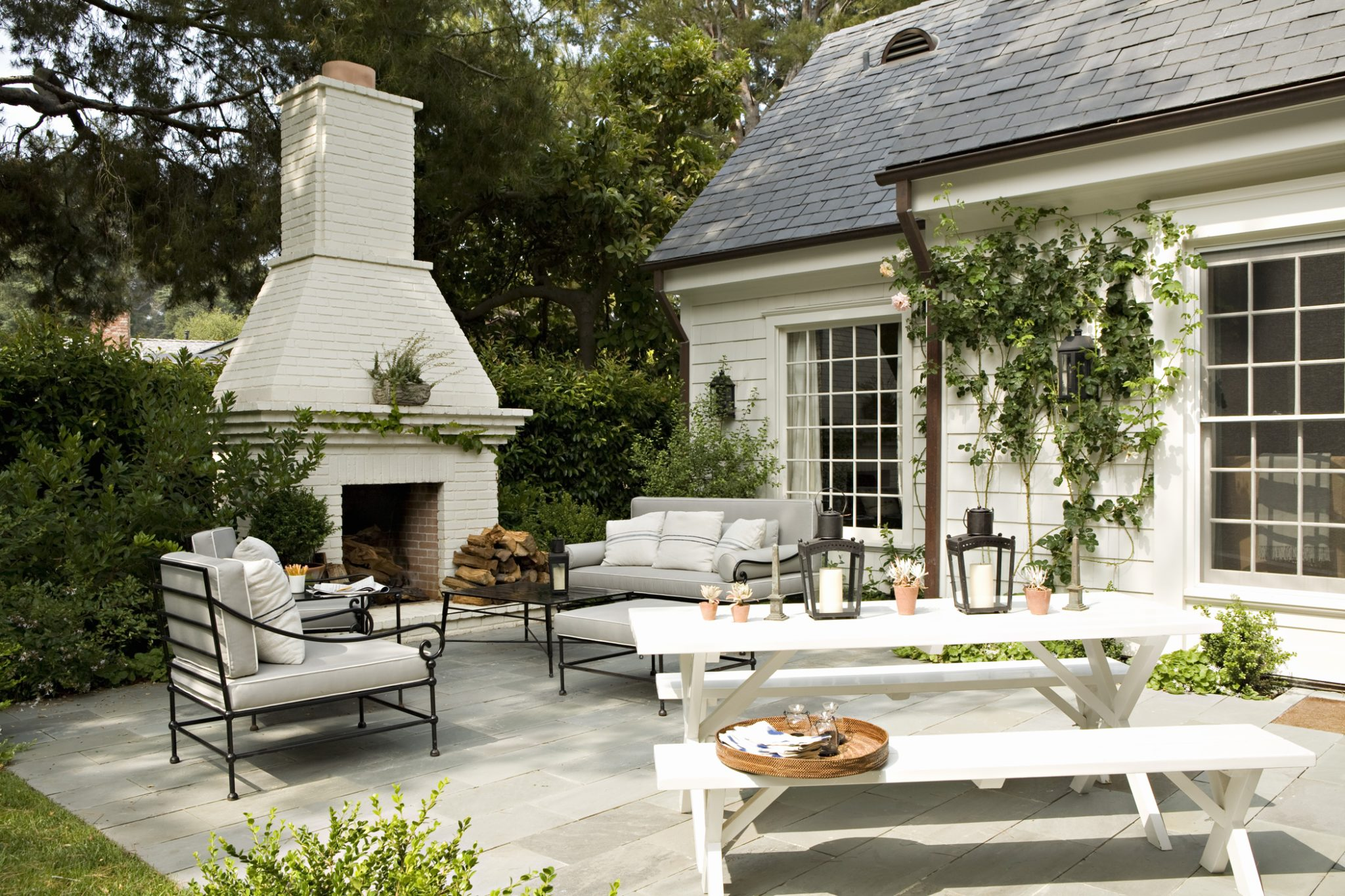 Outdoor Fireplace and Patio at a Custom Colonial Home by Tim Barber Ltd.