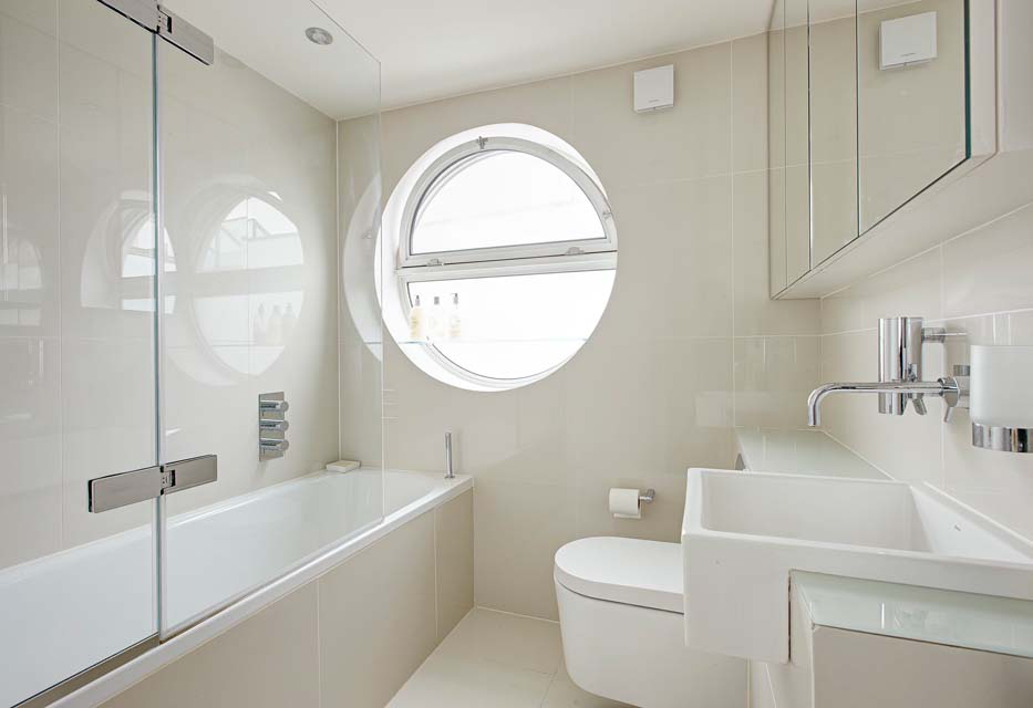 In the guest bathroom, the wall and floor tiles are by Walton Ceramics.