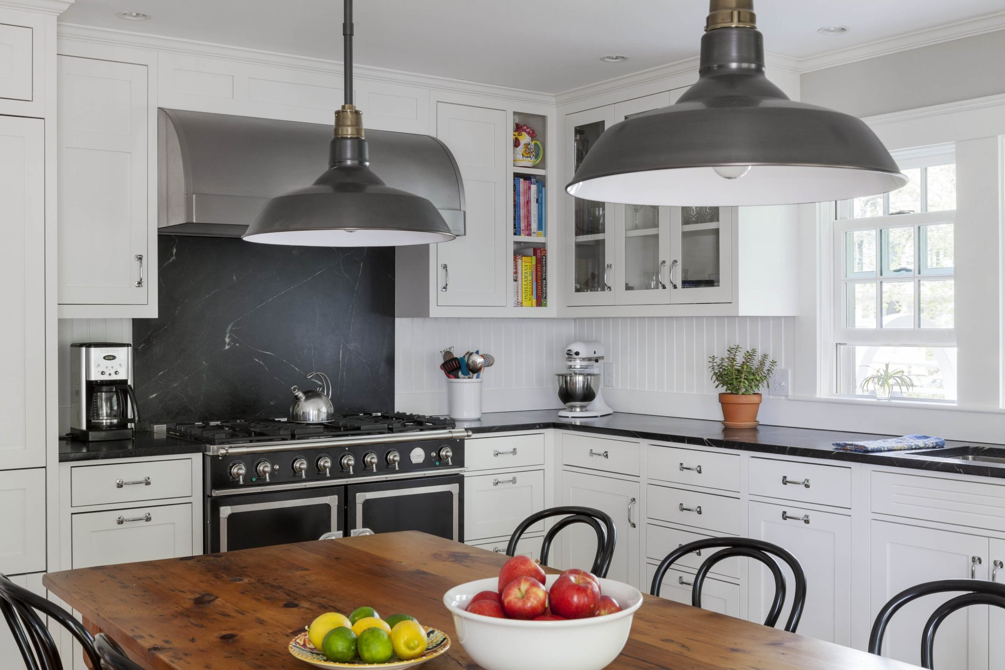 Black and white kitchen with soapstone backsplash by Jeanne Finnerty